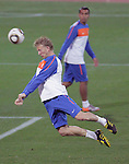 Netherlands' Dirk Kuyt heads a ball during a soccer training session at the Gelvendale stadium in Port Elizabeth July 1, 2010. REUTERS/Michael Kooren (SOUTH AFRICA) ...