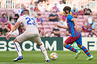 29th August 2021; Nou Camp, Barcelona, Spain; La Liga football league, FC Barcelona versus Getafe; Gavi of FC Barcelona breaks, covered by Mitrovic of Getafe