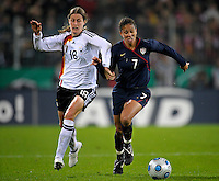 Shannon Boxx (7) dribbles against Kerstin Garefrekes (18). US Women's National Team defeated Germany 1-0 at Impuls Arena in Augsburg, Germany on October 27, 2009.