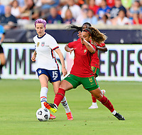 HOUSTON, TX - JUNE 10: Andreia Norton #8 of Portugal attempts to strip the ball from Megan Rapinoe #15 of the United States during a game between Portugal and USWNT at BBVA Stadium on June 10, 2021 in Houston, Texas.