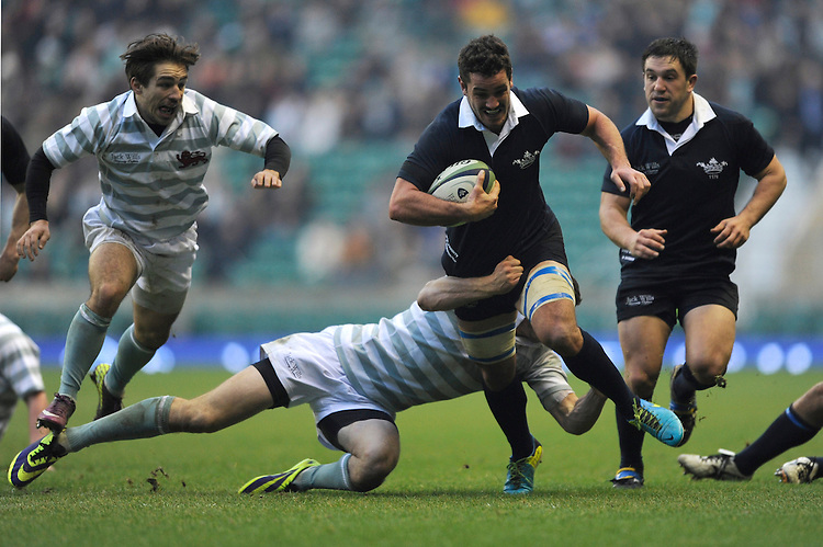 Alexander Macdonald of Oxford University is tackled during the 132nd Varsity Match between Oxford University and Cambridge University at Twickenham Stadium on Thursday 13th December 2013 (Photo by Rob Munro)