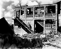A Marine from the Third Marine Division goes after a sniper in a shelled building, Guam, August 1944.  Cpl. J. F. Andrejka (Marine Corps)<br /> Exact Date Shot Unknown<br /> NARA FILE #:  127-N-151749<br /> WAR & CONFLICT BOOK #:  1190