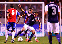SAN JOSE, COSTA RICA - September 06, 2013: Clint Dempsey (8) of the USA MNT is held by Michael Umana (4) of the Costa Rica MNT during a 2014 World Cup qualifying match at the National Stadium in San Jose on September 6. USA lost 3-1.