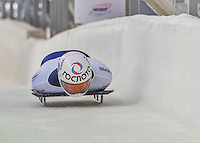 9 January 2016: Anton Batuev, competing for Russia, crosses the finish line on his second run of the day during the BMW IBSF World Cup Skeleton Championships at the Olympic Sports Track in Lake Placid, New York, USA. Batuev ended the day with a combined 2-run time of 1:50.89 and an 11th place overall finish. Mandatory Credit: Ed Wolfstein Photo *** RAW (NEF) Image File Available ***