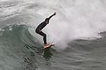 Surfers surf city surfer Surfing surfboard Seal Beach California.  Photograph by Alan Mahood.