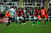 Saturday 17 November 2012<br /> Pictured: Angel Rangel of Swansea (with ball) marked by Cheick Tiote (C) of Newcastle.<br /> Re: Barclay's Premier League, Newcastle United v Swansea City FC at St James' Park, Newcastle Upon Tyne, UK.