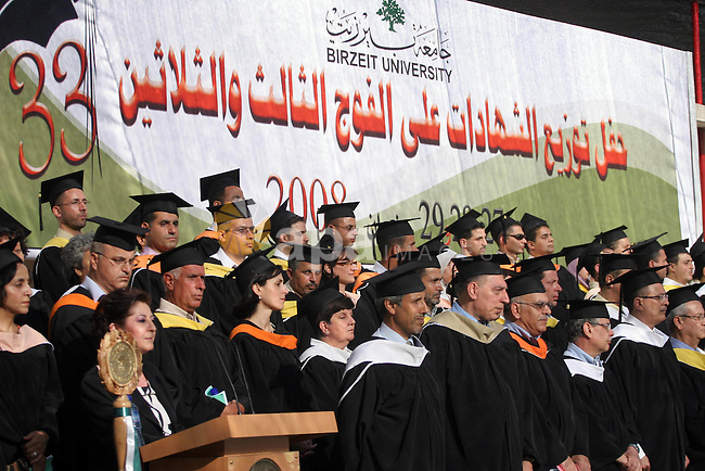 Palestinian students hold their graduation certificates as they celebrate at a graduation ceremony in Birzeit University near the West Bank city of Ramallah.
