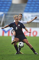 Lauren Cheney duals for a loose ball with a German defender during the 2010 Algarve Cup Final in Faro, Portugal on March 3, 2010. The US won 3-2.