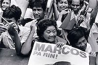 Janary and February 1986 were memorable days in the Philippines. The fall of dictator Ferdinand Marcos and the rise of the first so called democraticly chosen President Cory Aquino. Helped by the massive public support of People Power. The very last day of Marcos. They flew out on an American helicopter at the evening. His troops had disappeared.Here some last hard core fans.