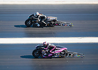 Nov 3, 2019; Las Vegas, NV, USA; NHRA pro stock motorcycle rider Matt Smith (near) against Katie Sullivan during the Dodge Nationals at The Strip at Las Vegas Motor Speedway. Mandatory Credit: Mark J. Rebilas-USA TODAY Sports