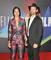 """Gala Botero and Byron Broadbent at the 65th BFI London Film Festival """"The Souvenir Part II"""" The Londoner gala, Royal Festival Hall, Belvedere Road, on Friday 08th October 2021, in London, England, UK. <br /> CAP/CAN<br /> ©CAN/Capital Pictures"""