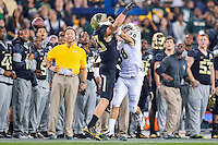 January 01, 2014:<br /> <br /> UCF Knights defensive back Jordan Ozerities #38 breaks up a pass intended for Baylor Bears wide receiver Clay Fuller #23 during Tostitos Fiesta Bowl at University of Phoenix Stadium in Scottsdale, AZ. UCF defeat Baylor 52-42 to claim it's first ever BCS Bowl trophy.
