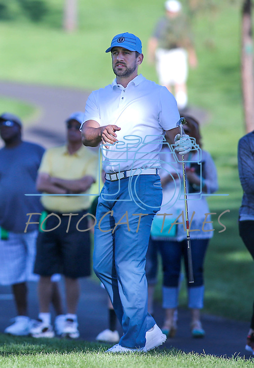 NFL quarterback Aaron Rodgers watches a shot in the final round of the American Century Championship at Edgewood Tahoe Golf Course in Stateline, Nev., on Sunday, July 19, 2015. <br /> Photo by Cathleen Allison
