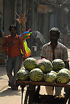 Street Vendors selling water melons and balloons in the Paharganj district of New Delhi, India.