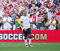 Clint Dempsey (8) of the USMNT salutes the crowd after the game at RFK Stadium in Washington DC.  The USMNT defeated Germany, 4-3, in a friendly match.