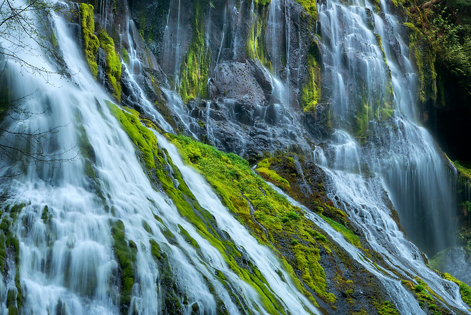 A telephoto lens was used to frame an interesting interplay of diagonals crossing over the mossy rocks of Panther Creek Falls in eastern Washington.<br /> <br /> ARTIST CHOICE: 24x36 Lumachrome/Acylic