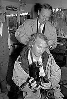 Montreal, August 25, 1988 File Photo.<br /> The leader of Liberal Party of Canada ;  Jean ChrÈtien pretend to cut hair of Montreal Gazette photographer Dave Sidaway while the owner of the barbershop is watching, during the 1988 Federal electoral campaign.<br /> Jean Chretien defeated Brian Mulroney in the 1988 elections and is still Prime Minister to this date (april 2000)<br /> <br /> Photo by Pierre Roussel, IMAGES DISTRIBUTION