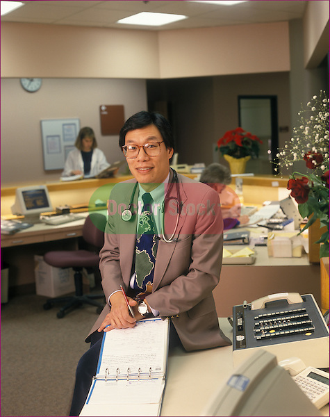 portrait of doctor in nurses' station of hospital