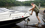 SOUTHBURY CT. 04 July 2015-070415SV03-Carlos Vargas of Southington launches his boat at the Lake Zoar boat launch in Southbury Saturday.<br /> Steven Valenti Republican-American