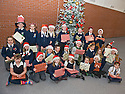 16/12/2010   Copyright  Pic : James Stewart.002_carol_singers  .::  SERCO :: PUPILS FROM LARBERT VILLAGE PRIMARY SCHOOL RECEIVE THEIR CHRISTMAS GIFTS AFTER SINGING CAROLS FOR THE STAFF AND VISITORS AT THE FORTH VALLEY ROYAL HOSPITAL RESTAURANT   ::