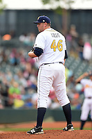Montgomery Biscuits pitcher Matt Lollis (46) looks in for the sign during a game against the Mississippi Braves on April 22, 2014 at Riverwalk Stadium in Montgomery, Alabama.  Mississippi defeated Montgomery 6-2.  (Mike Janes/Four Seam Images)