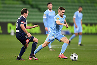 6th June 2021; AAMI Park, Melbourne, Victoria, Australia; A League Football, Melbourne Victory versus Melbourne City; Leigh Broxham of the Victory beaten by the run from Ben Garuccio of Melbourne City