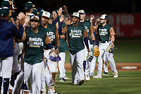 Abiezel Ramirez (2) of the Charleston Boiled Peanuts celebrates with teammates after their win over the Augusta GreenJackets at Joseph P. Riley, Jr. Park on June 26, 2021 in Charleston, South Carolina. (Brian Westerholt/Four Seam Images)
