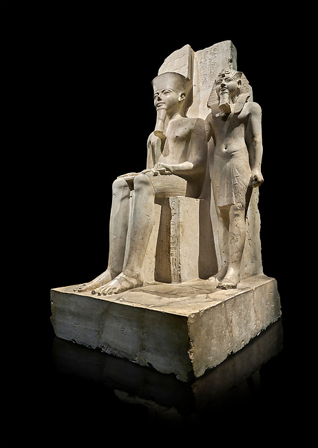 Ancient Egyptian statue of pharaoh Horemheb with god Amun, limestone, New Kingdom, 18th Dynasty, (1319-1292 BC). Egyptian Museum, Turin. black background.<br /> <br /> Horemheb stands beside the taller depiction of the god Amun. The statue is typical of the period following the religious and artistic revolution of King Akhenaten. The muscles are not emphasised and the contours are soft, with rounded hips and juvenile faces, the eyes are almond shaped and the cheeks and lips sensual. Some scholars believe this may have been a statue of Tutenkhamon remodelled by Horemheb. Dorvetti collection. C 768