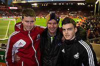 Swansea City fans pictured inside Anfield ahead of the Barclays Premier League Match between Liverpool and Swansea City played at Anfield, Liverpool on 29th November 2015