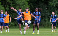 Danny Rowe holds off Paris Cowan-Hall (left) & Marcus Bean during the Wycombe Wanderers 2016/17 Pre Season Training Session at Wycombe Training Ground, High Wycombe, England on 1 July 2016. Photo by Andy Rowland / PRiME Media Images.