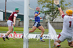 Fionan Mackessy, St. Brendans, scores a goal despite the attention of Muiris Delaney, Causeway, during the County Senior hurling Semi-Final between St. Brendans and Causeway at Austin Stack park on Sunday.