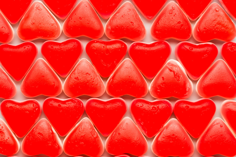 Valentine bnackground with red hearts of candy