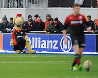 20130324 Copyright onEdition 2013©.Free for editorial use image, please credit: onEdition..Sarrie the Camel watches as Owen Farrell of Saracens prepares to take a kick during the Premiership Rugby match between Saracens and Harlequins at Allianz Park on Sunday 24th March 2013 (Photo by Rob Munro)..For press contacts contact: Sam Feasey at brandRapport on M: +44 (0)7717 757114 E: SFeasey@brand-rapport.com..If you require a higher resolution image or you have any other onEdition photographic enquiries, please contact onEdition on 0845 900 2 900 or email info@onEdition.com.This image is copyright onEdition 2013©..This image has been supplied by onEdition and must be credited onEdition. The author is asserting his full Moral rights in relation to the publication of this image. Rights for onward transmission of any image or file is not granted or implied. Changing or deleting Copyright information is illegal as specified in the Copyright, Design and Patents Act 1988. If you are in any way unsure of your right to publish this image please contact onEdition on 0845 900 2 900 or email info@onEdition.com