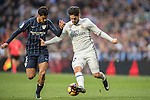 Isco (r) of Real Madrid competes for the ball with Roberto Rosales of Malaga CF during their La Liga 2016-17 match between Real Madrid and Malaga CF at the Estadio Santiago Bernabéu on 21 January 2017 in Madrid, Spain. Photo by Diego Gonzalez Souto / Power Sport Images
