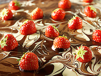 white and milk chocolate swirls with strawberries.