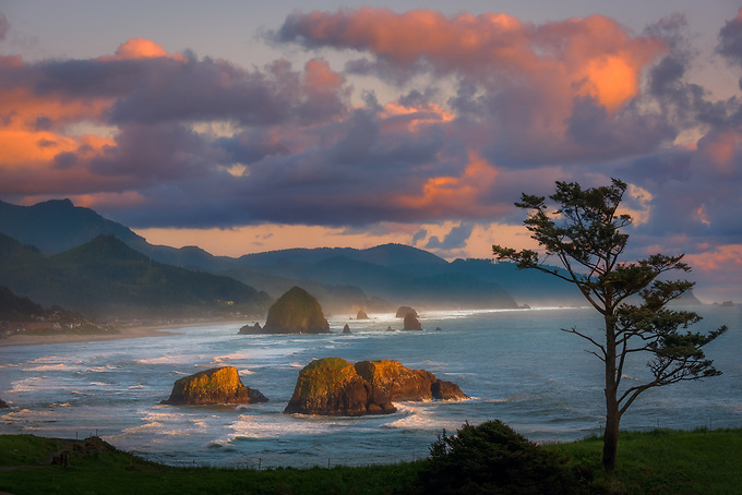 A colofrul sky frames this classic postcard scene from Oregon's picturesque Cannon Beach at sunset.<br /> <br /> ARTIST CHOICE: 20x30 Lumachrome/Acylic