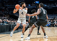 WASHINGTON, DC - FEBRUARY 19: Jagan Mosely #4 of Georgetown pulls the ball back from Alpha Diallo #11 of Providence during a game between Providence and Georgetown at Capital One Arena on February 19, 2020 in Washington, DC.