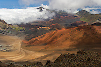 The island of Maui is comprised of two separate volcanic eruptions.  A map of Maui shows these two distinct land masses.  This is the Haleakala Volcano National Park. In contrast to the black lava of the active volcano on the Big Island, this old inactive volcano has many different earth tones showing the varied mineral content of the lava.