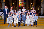 MS Dineen's class previously Ms Ryles class Pupils of CBS Primary School, Tralee with their teachers, Denis Coleman (principal),Siobhan Ryle and Mairead Dineen and Fr Tadhg Fitzgerald after their First Holy Communion in St John's Church, Tralee on Saturday.