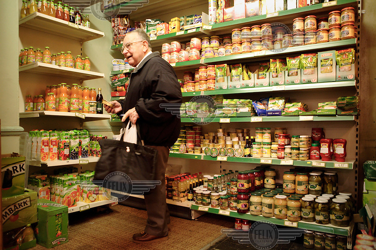 A Polish man buying Polish foodstuffs at the White Eagle in Balham, London. The club is a gathering place for the Polish expatriate community.