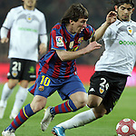 Football Season 2009-2010. Barcelona's player Lionel Messi scapes to score first goal during their spanish liga soccer match between Barcelona vs Valencia at Camp Nou  stadium in Barcelona. 14 March 2010.
