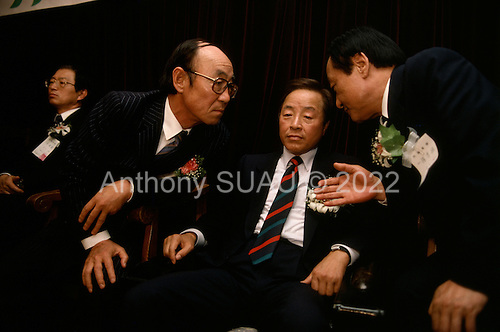 """Seoul, South Korea.May 1, 1987..Political leader Kim Young Sam (center) attends the formation of a new opposition party...After two decades of building an economic miracle, in the summer of 1987 tens of thousands of frustrated South Korean students took to the streets demanding democratic reform. """"People Power"""" Korean-style saw Koreans from all social spectrums join in the protests...With the Olympics to be held in South Korea in 1988, President Chun Doo Hwan decided on no political reforms and to choose the ruling party chairman, Roh Tae Woo, as his heir. The protests multiplied and after 3 weeks Chun conceded releasing oppositionist Kim Dae Jung from his 55th house arrest and shaking hands with opposition leader Kim Young Sam. Days later he endorsed presidential elections and an amnesty for nearly 3,000 political prisoners. It marked the first genuine initiative of democratic reform in South Korea and the people had their victory."""