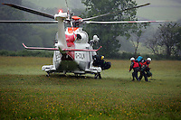 Pictured: A Coastguard helicopter lands in a field at Tafarn y Gerreg in Powys, Wales UK. Wednesday 29 June 2016<br />Re: Rescuers have found a number of the 24 children who went missing the Brecon Beacons.<br />Dyfed-Powys Police said a Coastguard helicopter had found some the children, who are from St Albans, Hertfordshire.<br />The helicopter has landed and the crew are with the children, but their condition is not known.<br />The alarm was raised at about 13:00 BST after the groups went missing around Llyn y Fan Fach, near Abercraf.<br />The children are in their mid teens and were on the beacons as part of their Duke of Edinburgh Award.<br />Mark Moran from Central Beacons Mountain Rescue said his team had been in intermittent phone contact with the four groups of six children before the first group were found.