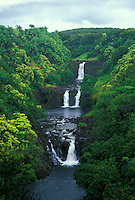 Scenic Umauma Falls.  Located a short drive north of Hilo along the Hamakua coast of the Big Isle of Hawaii. Access to the falls is thru the World Botanical Gardens.