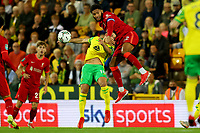 21st September 2021; Carrow Road, Norwich, England; EFL Cup Footballl Norwich City versus Liverpool; Joe Gomez of Liverpool wins a header against Christos Tzolis of Norwich City