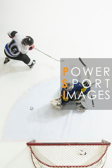 Verity Team Goalkeeper #33 Sam Wong (right) defends against Gaggia Empire Skater #10 Otto Chan during the match Gaggia Empire vs Verity, a match part of the Principal Standard League on 07 March 2017 in Mega Ice, Hong Kong, China. Photo by Marcio Rodrigo Machado / Power Sport Images