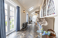 BNPS.co.uk (01202) 558833. <br /> Pic: LuxuryAndPrestige/BNPS<br /> <br /> Pictured: Hallway. <br /> <br /> A heavenly converted chapel that has been transformed into a contemporary home is on the market for £1.5m.<br /> <br /> The Old Chapel was used by an order of nuns for 139 years before the humble church got a stylish upgrade into a four-bedroom property.<br /> <br /> The Grade II listed building has been carefully restored to retain stunning ecclesiastical features like windows, archways and doors, but with a modern twist.<br /> <br /> And although the owner bought it from the developer before it was finished, the stunning home has never been lived in.