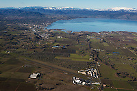 aerial photograph of Lampson Field airport, Lakeport, Lake County, California toward Lakeport and Clear Lake during the winter; north of Lakeport in the background are the mountains of the Mendocino National Forest, including, in the center background, Snow Mountain, part of the Snow Mountain Wilderness. The summit of East Snow Mountain's has an elevation of 7056', the highest elevation in Lake County.