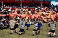 Dance troops preform at the Litang Horse Festival, representing various regions of Kham - Sichuan Province, China, (Tibet)
