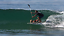 Jeremy Fry rides a wave on his stand-up paddle board accompanied by his three Jack Russell terriers at Cardiff Reef.  photo for North County Times